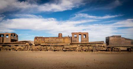 Abandoned rusty old train cemetery in train - Uyuni, Bolivia