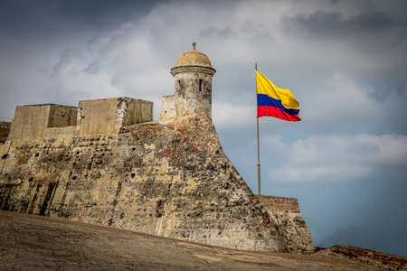 Castillo de San Felipe and Colombian flag - Cartagena, Colombia