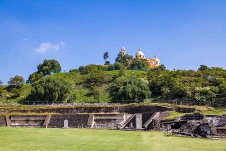 Ruins of Cholula pyramid with Church of Our Lady of Remedies at the top of it - Cholula, Puebla, Mexico