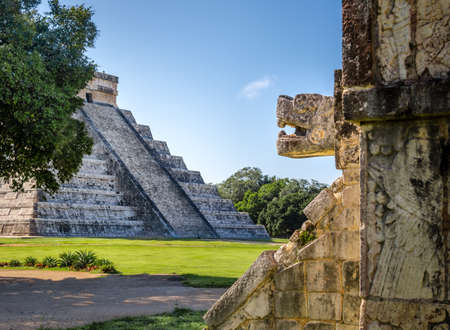 Jaguar head and Mayan Temple pyramid of Kukulkan - Chichen Itza, Yucatan, Mexico