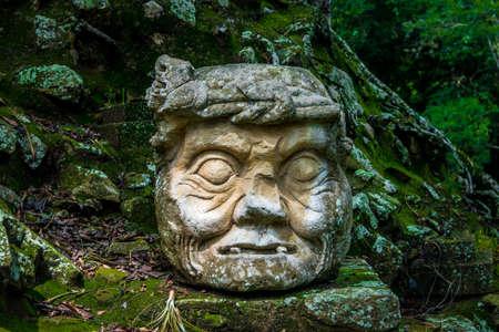 Carved old man head at Mayan Ruins - Copan Archaeological Site, Honduras