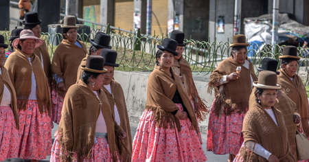 collective bargaining: Traditional Women (Cholitas) in Typical Clothes During 1st of May Labor Day Parade - La Paz, Bolivia