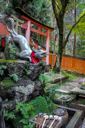 shinto: Fox Statue Water fountain in Fushimi Inari Shrine - Kyoto, Japan