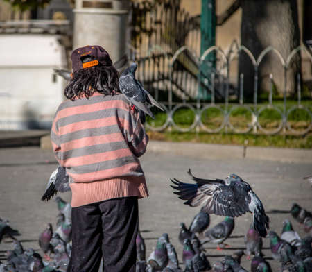 murillo: Boy feeding pidgeons on Plaza Murillo - La Paz, Bolivia