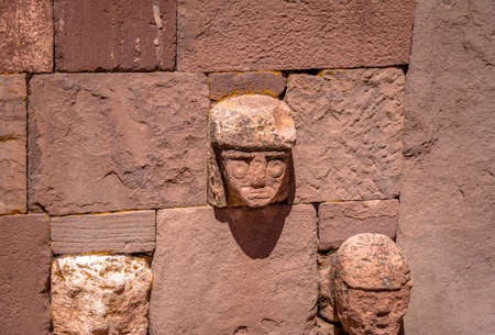 tenon: Carved Stone Tenon Heads of Kalasasaya Temple of Tiwanaku (Tiahuanaco) culture - La Paz Bolivia Stock Photo