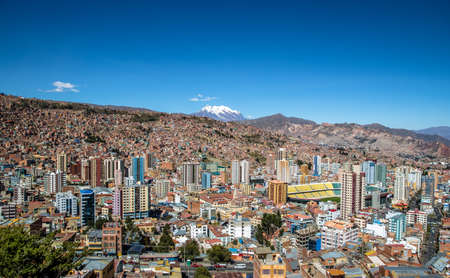 Aerial view of La Paz city with Illimani Mountain on background - La Paz, Bolivia Imagens