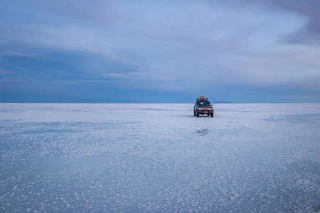 Off-road vehicle at sunrise in Salar de Uyuni salt flat - Potosi Department, Bolivia