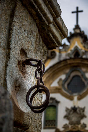 Iron handcuffs used to torture slaves in front of the church - Mariana, Minas Gerais, Brazil Stock Photo