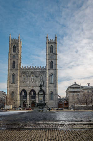 plaza of arms: Basilica of Notre-Dame of Montreal and Place dArmes on snow - Montreal, Quebec, Canada