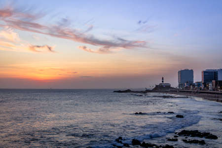 Sunset at Barra Beach with Farol da Barra (Barra Lightouse) on Background - Salvador, Bahia, Brazil Imagens