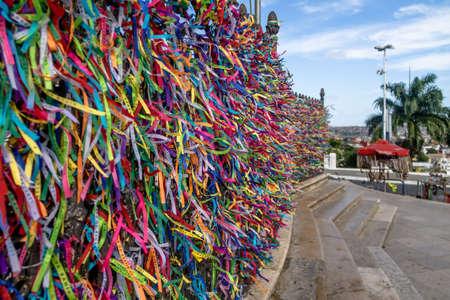 Colorful ribbons of Lord of Bonfim in front of Nosso Senhor do Bonfim Church - Salvador, Bahia, Brazil Imagens