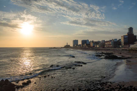 Sunset at Barra Beach with Farol da Barra (Barra Lightouse) on Background - Salvador, Bahia, Brazil Banco de Imagens
