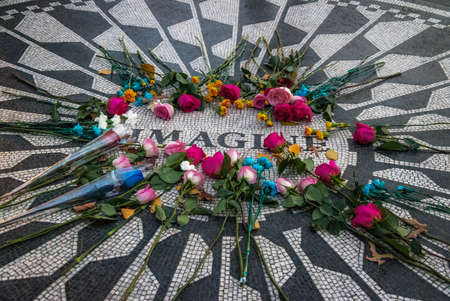 The Imagine mosaic with flowers on day of John Lennon death at Strawberry Fields in Central Park, Manhattan - New York, USA