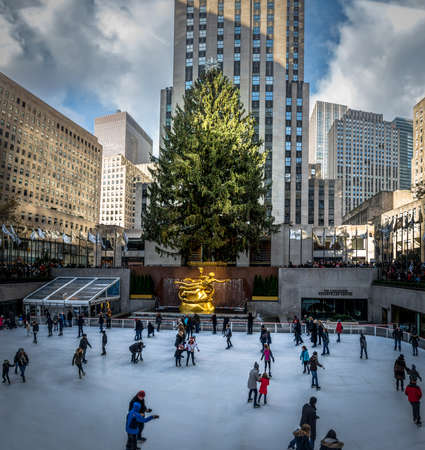People ice skating in front of Rockefeller Center Christmas Tree - New York City, USA