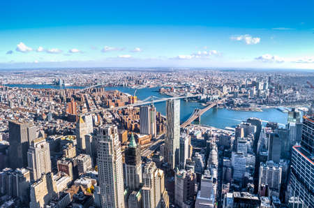 Skyline aerial view of Manhattan with skyscrapers, East River, Brooklyn Bridge and Manhattan Bridge - New York City, USA Stock Photo