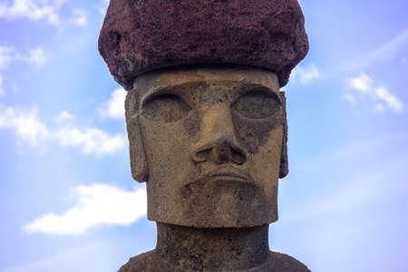 rapanui: Close view of  Moai Statue Face of Ahu Nau Nau wearing topknot near Anakena Beach - Easter Island, Chile