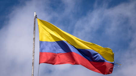 governement: Waving Colombian Flag on a Blue Sky - Bogota, Colombia