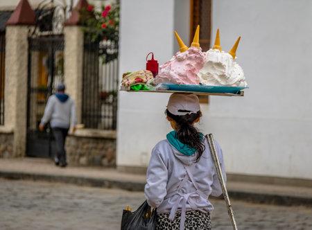Typical spice (meringue like dessert on ice cream cone) street vendor - Cuenca, Ecuador
