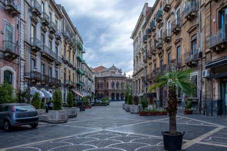 Street of Catania with the famous Opera Theatre Teatro Bellini on background - Catania, Sicily, Italy