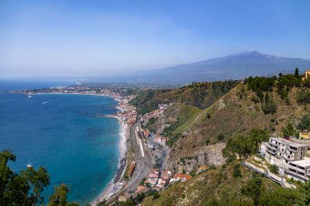 ionian: Aerial view of Taormina city, mediterranean sea and Mount Etna Volcano - Taormina, Sicily, Italy Stock Photo
