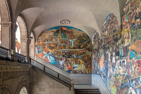 The stairs of National Palace with the famous mural Class Struggle and The History of Mexico by Diego Rivera - Mexico City, Mexico