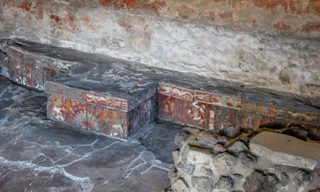 archaeological: Colorful bas relief carving in stone benches of Aztec Temple (Templo Mayor) at ruins of Tenochtitlan - Mexico City, Mexico Editorial