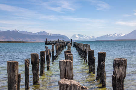 magallanes: Old Dock in Almirante Montt Gulf in Patagonia - Puerto Natales, Magallanes Region, Chile Stock Photo
