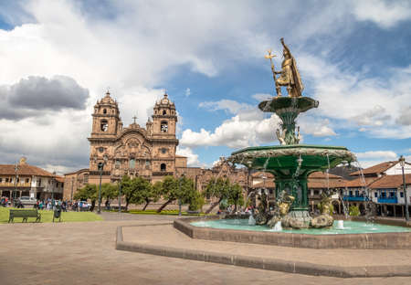 Plaza de Armas with Inca Fountain and Compania de Jesus Church - Cusco, Peru