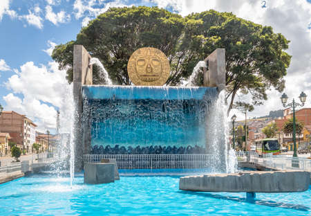 Water fountain monument with Golden Inca Sun Disc in the streets of Cusco City - Cusco, Peru