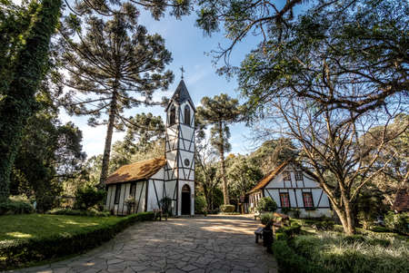 colonial church: German Fachwerk Style Church and houses at Immigrant Village Park (Parque Aldeia do Imigrante) - Nova Petropolis, Rio Grande do Sul, Brazil Stock Photo