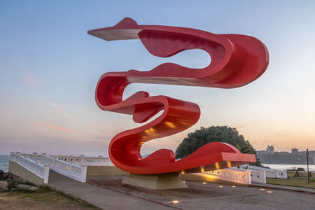 Sculpture by Tomie Ohtake at Marine Outfall at sunset - Santos, Sao Paulo, Brazil