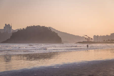 Santos Beach and Urubuquecaba island at sunset - Santos, Sao Paulo, Brazil Editorial