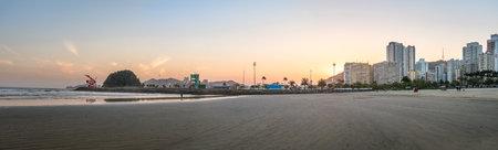 Panoramic view of Santos Beach, city and Urubuquecaba island at sunset - Santos, Sao Paulo, Brazil Editorial
