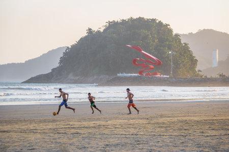 People playing soccer at Santos Beach - Santos, Sao Paulo, Brazil Editorial