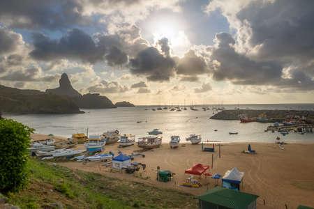 Aerial view of Sunset at Praia do Porto and Port of Santo Antonio with Morro do Pico on background - Fernando de Noronha, Pernambuco, Brazil Stok Fotoğraf