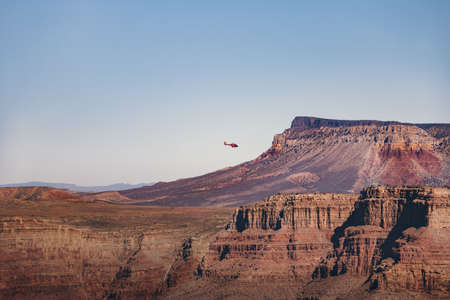 Helicopter flying over Grand Canyon West Rim - Arizona, USA 写真素材