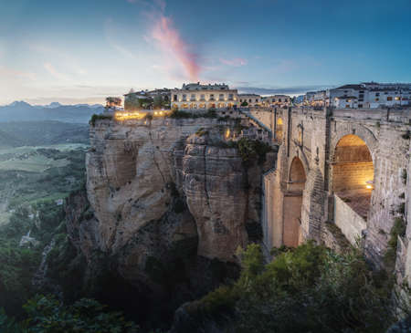 Aerial view of Tajo Gorge and Ronda Puente Nuevo Bridge at sunset - Ronda, Malaga Province, Andalusia, Spain