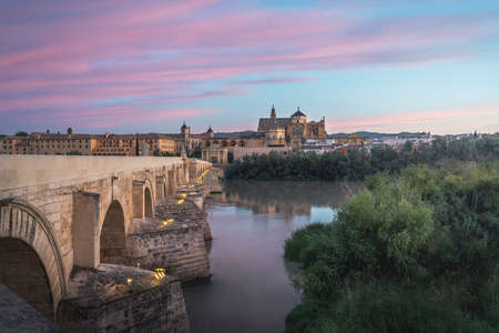 Cordoba skyline at sunrise with Old Roman Bridge and Mosque Cathedral - Cordoba, Andalusia, Spain 版權商用圖片