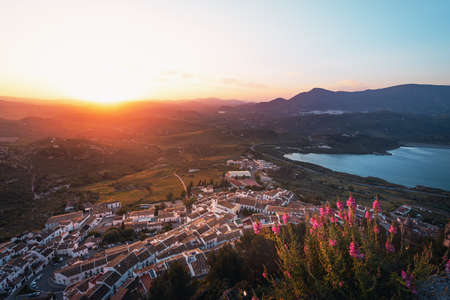 Aerial view of Zahara de la Sierra city at sunset - Zahara de la Sierra, Cadiz Province, Andalusia, Spain