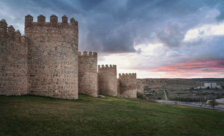 Medieval Walls of Avila City at sunset - Avila,  Castile and Leon, Spain 版權商用圖片 - 130138199