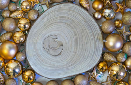 Christmas background and holiday decorations with wooden log