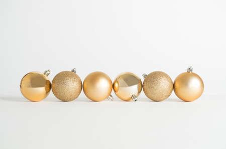 Christmas decorations, golden spheres on white background Archivio Fotografico