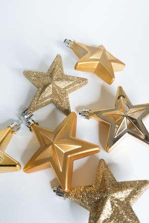 Christmas decorations, golden stars on white background