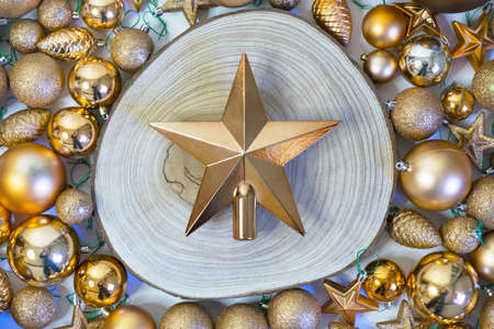 Christmas Golden Star on wooden log and holiday decorations