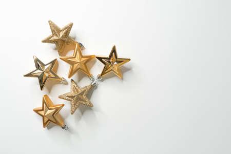Golden christmas stars on white background