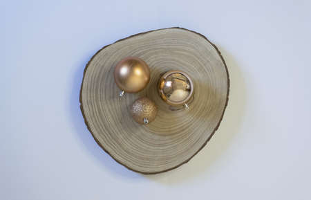 Christmas background with golden balls on wooden log
