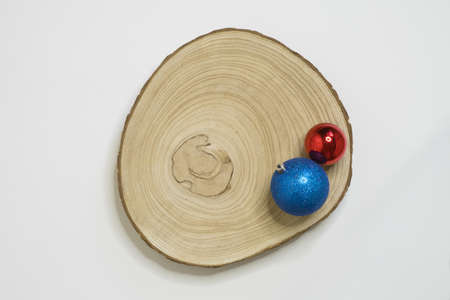 Wooden log with simple christmas decoration and white background