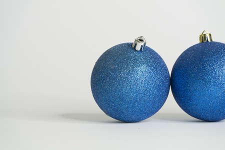 Blue christmas balls white background and last shiny sphere