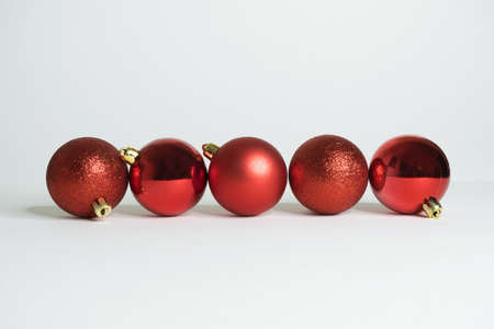 Red christmas balls with white background