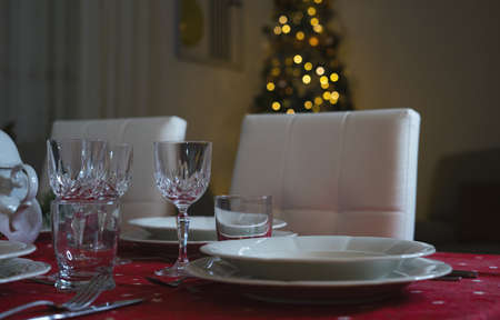 Close up shot of wine glasses at Christmas dinner table Archivio Fotografico